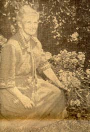 Miss Marguerite Davis, co-discoverer of Vitamin A and Vitamin B, in the garden of the home where three generations of her family have lived. Miss Davis has restored the home as closely as possible to its original state.
