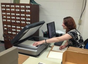 Alicia Ryan, history major at UW-Parkside, scanning the Eugene Leach collection
