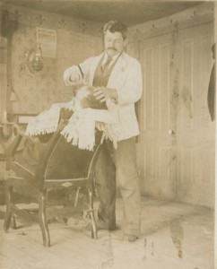 Jacob A. Bernhard shaving a customer, about 1900
