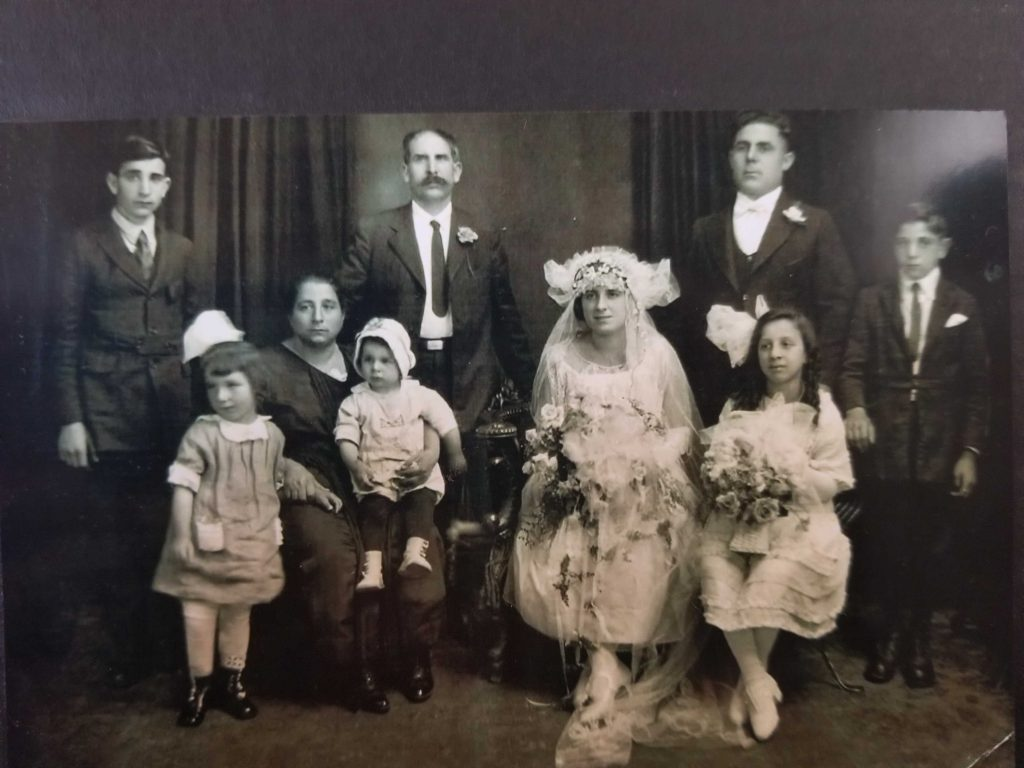 "Wedding of Carmela DiPasquale and Angelo Puma, 1923. Tanya Craig says that Carmela's name is misspelled over and over. Tanya Craig also says: ""My Grandmother's sister who is still alive (100 yrs old) said he came to their parents' house and asked to marry her. No one,  not even my grandma,  knew him. He was told no. He then threatened to kidnap her. So they agreed in fear they wouldn't see her again."""